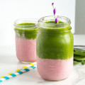 Strawberry and Green Banana Layered Smoothie | nourishedtheblog.com | feature image