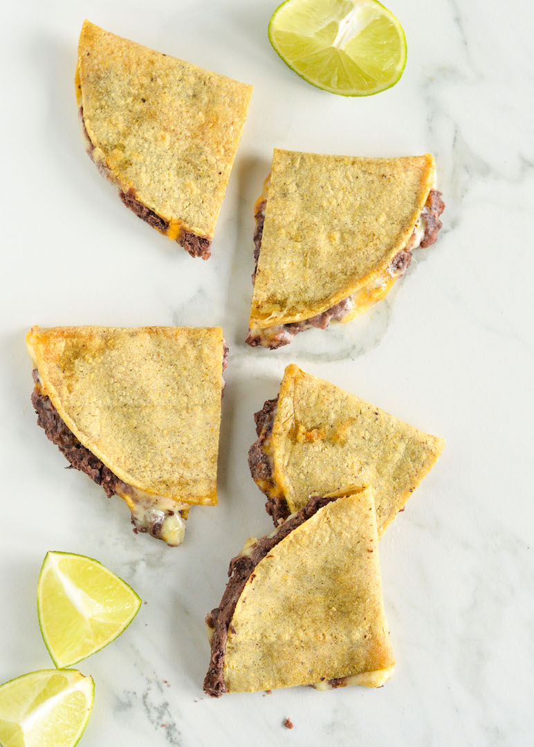 | recipe | Easy Cheesy Black Bean Quesadillas with Guacamole made gluten free, vegetarian and delicious with corn tortillas, lots of melted cheese and a spicy yet super flavourful black bean puree.
