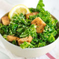 Leafy green kale tossed in a homemade lemon garlic and olive oil caesar dressing and topped with lots of homemade (and gluten free) croutons makes for the perfect lunchtime salad or side dish to just about any dinner.