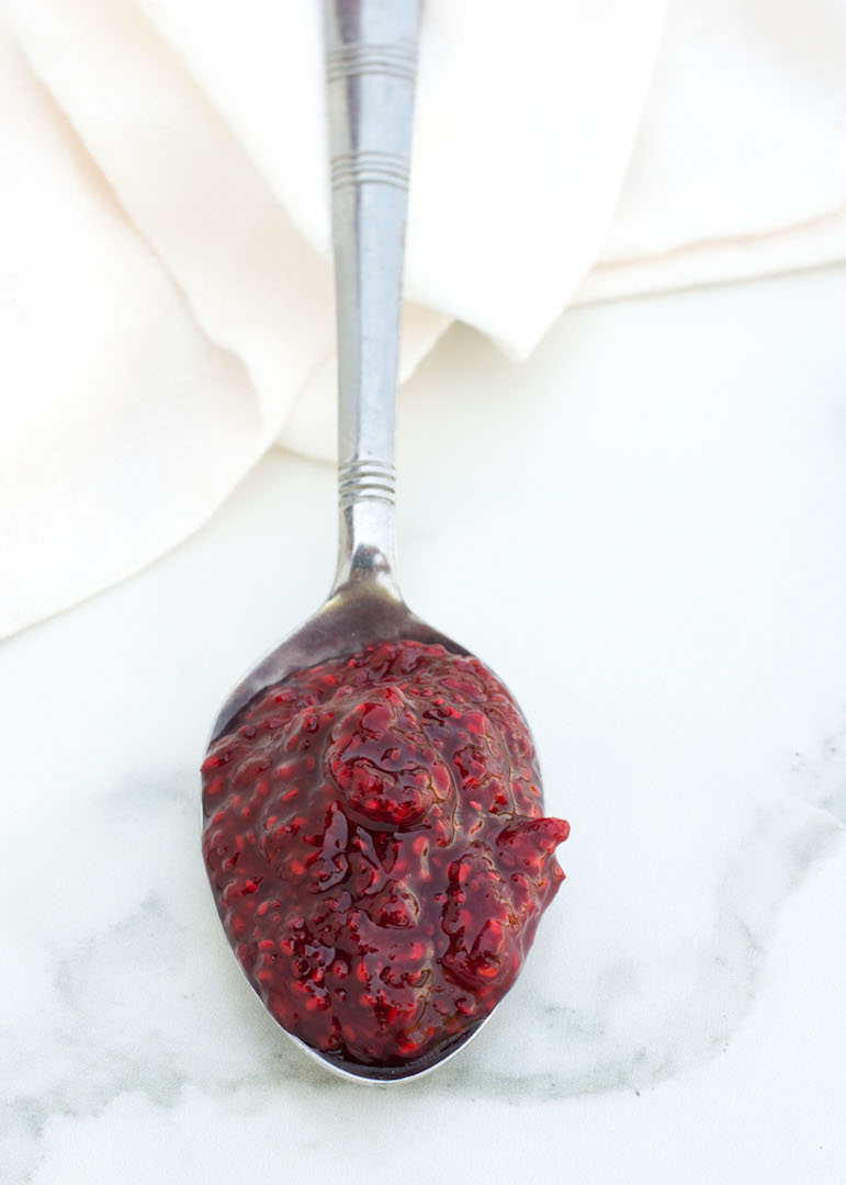 Easy Raspberry Chia Seed Jam | nourishedtheblog.com | An Easy Raspberry Chia Seed Jam recipe made gluten free, vegan and healthy with only 4 ingredients - raspberries, lemon juice, maple syrup and chia seeds. The perfect way to sweeten up your yogurts, oatmeals and toasts or to add a healthy kick to any dessert.