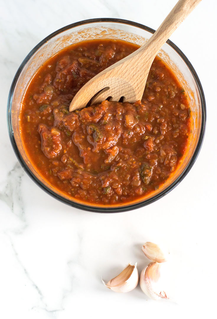 Healthy Tomato Basil Pasta Sauce From Scratch | A delicious and healthy tomato basil pasta sauce made gluten free and vegan with canned tomatoes, fresh basil, onions and lots of garlic. The perfect addition to any date-night dinner at home. Click through for the full recipe!