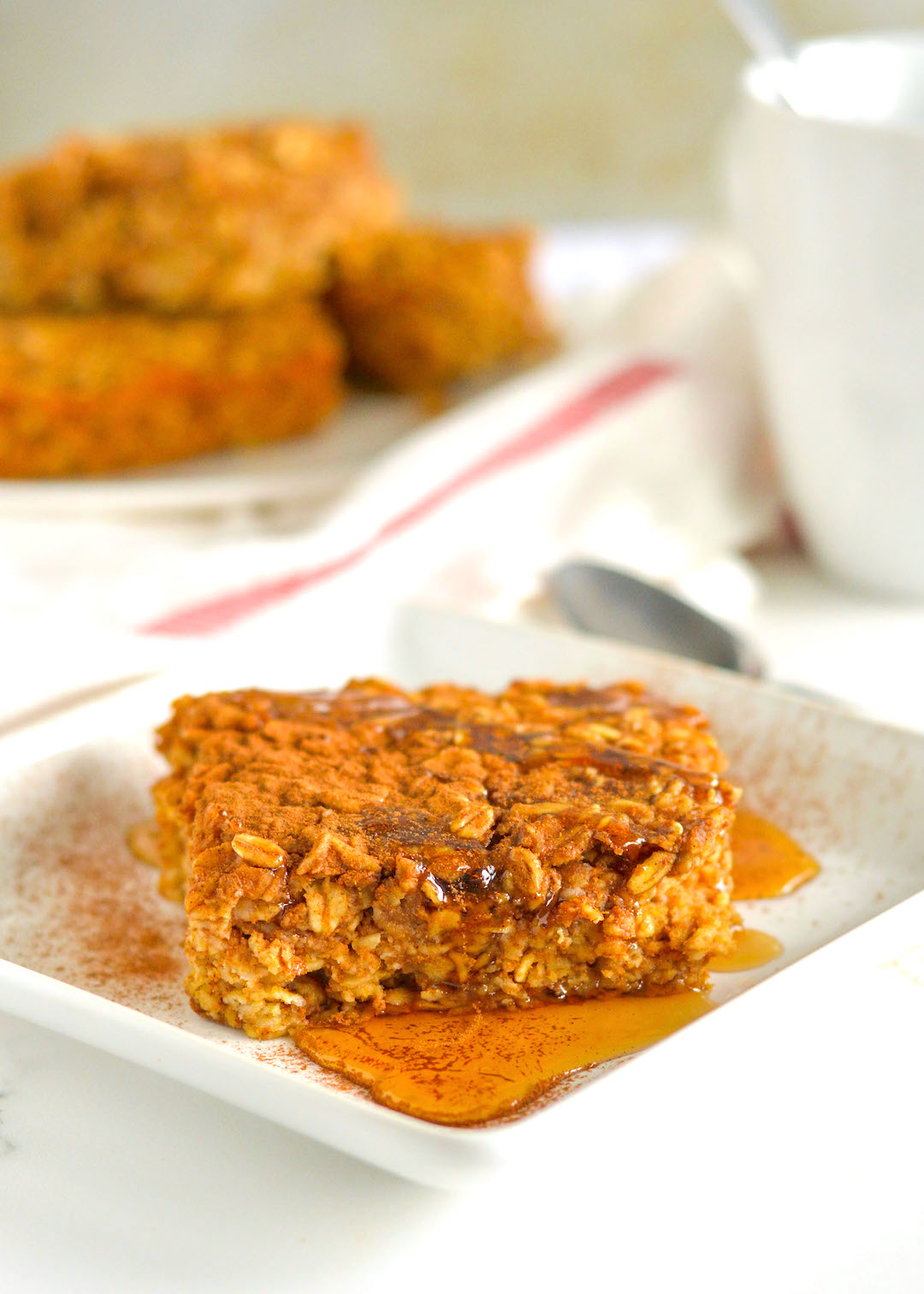 A healthy and gluten free Pumpkin Spice Baked Oatmeal recipe made with GF rolled oats, pumpkin, lots of pumpkin spice and topped with raw pumpkin seeds. | nourishedtheblog.com |