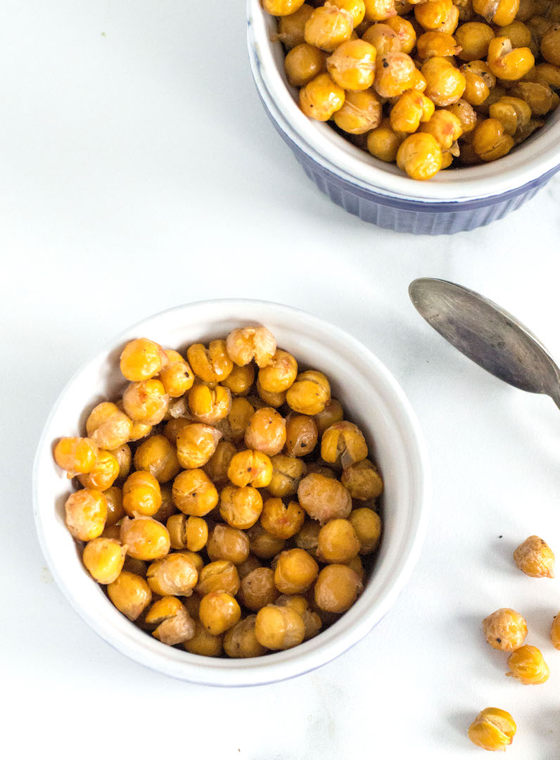 Crispy Roasted Chickpeas | nourishedtheblog.com | Crispy roasted chickpeas are my new favourite oven roasted snack. These crispy gluten free and vegan bites are full of healthy fiber and protein and are the best TV watching munchie.
