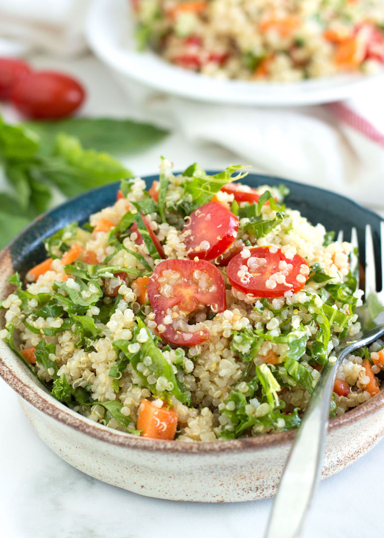 Easy Quinoa Salad with Garden Veggies | nourishedtheblog.com | An Easy Quinoa Salad with Garden Veggies recipe made gluten free and vegetarian friendly with carrots, peppers, tomatoes, herbs and kale in a sweet mustard dressing. Top with crumbled feta seeds for a little salty kick and with hemp seeds for extra nutrition.