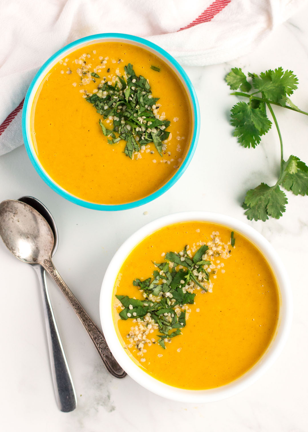 A curried butternut squash and apple soup recipe that's creamy and sweet and full of flavour. This is the perfect gluten free, vegan and easy to make soup to warm up with on a cool fall night.