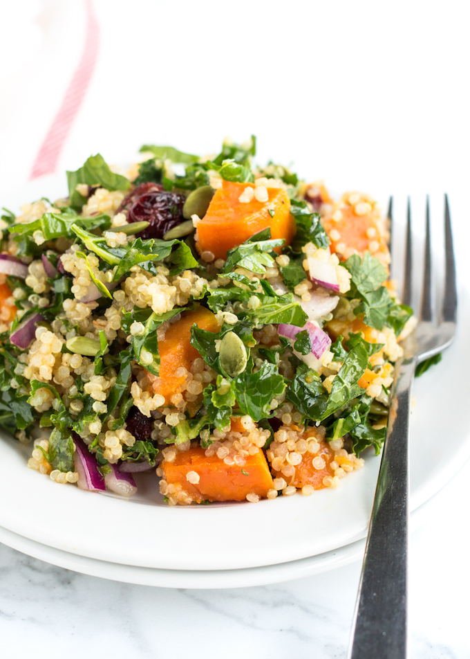A deliciously healthy and easy-to-make Roasted Sweet Potato Quinoa Salad recipe all dressed up in a zesty lime vinaigrette made gluten free and vegetarian-friendly with sweet potato, kale, quinoa, cranberries and pumpkin seeds.
